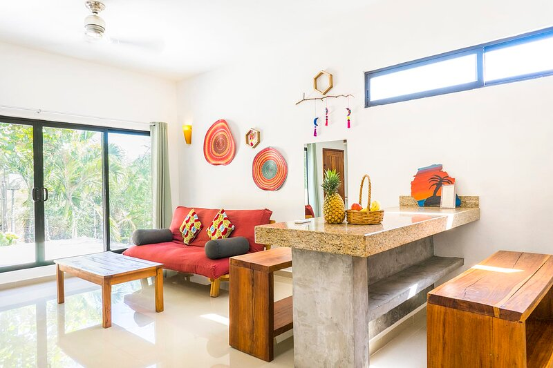 CONDO 3: w/cool tile flooring, high ceilings, colorful accents & private terrace!