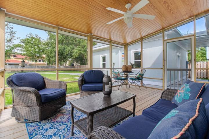 Brand new screened in porch with outdoor seating for your family to relax