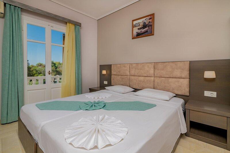 Double or Twin Side Sea View Room - Plaka Beach Resort, holiday rental in Vasilikos