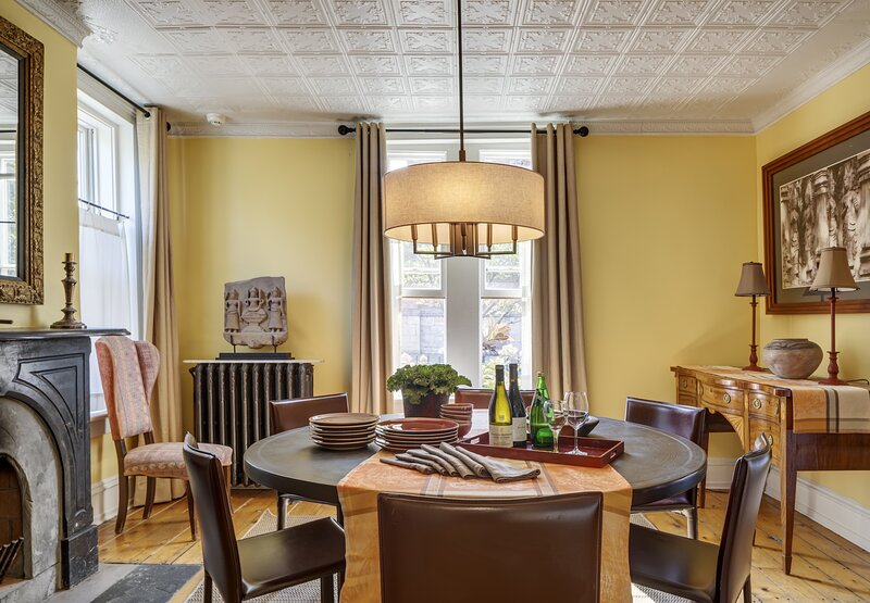 Autumn 2021 - This Burmese round dining table seats 8. Located just off kitchen.