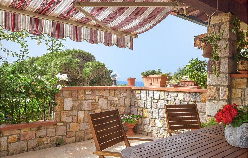 Nice home in Porto Scudo with Outdoor swimming pool and 1 Bedrooms (IGC110), holiday rental in Portoscuso