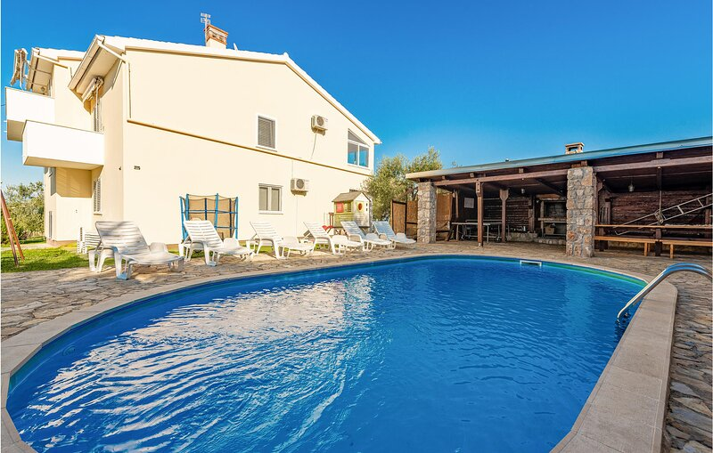 Awesome home in Pasman with Outdoor swimming pool and 4 Bedrooms (CDU359), alquiler vacacional en Mrljane