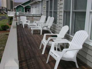deck facing tennis courts