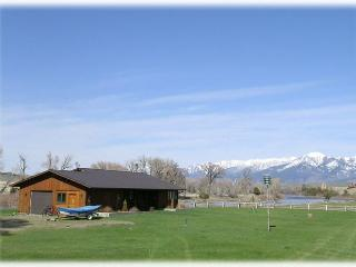 The front porch of the home looks out onto the spacious yard and incredible mountain views