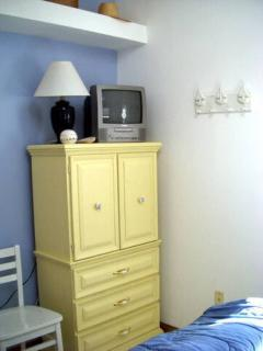 Full sized bedroom with TV
