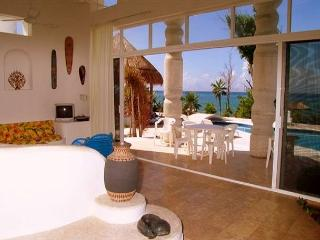 Spacious Living Area with ocean view and flat screen TV