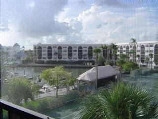 Condo in Waterfront Resort with views of the pool !  Close to shopping and Resta