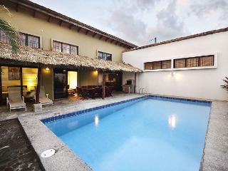 Spacious, modern home, large pool, 7 min walk to beach, WiFi, AC, sleeps 7-13