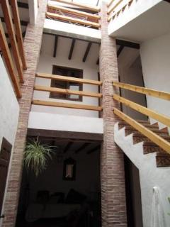 the atrium and stairs to the bedrooms