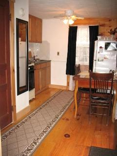 Kitchen: Stove, coffee maker, fridge, dining table, etc