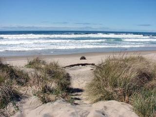 SAND & SURF~Quaint beach house just steps to the beach!!