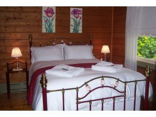 Bedroom 1, Warm, cosy, comfortable queen bed.  Garden views