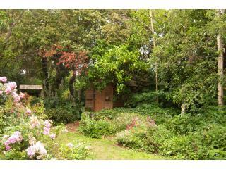 Potting Shed nestled in the gardens