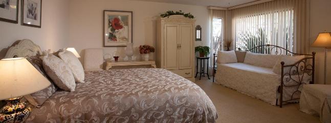 Main floor queen room with twin trundle bed
