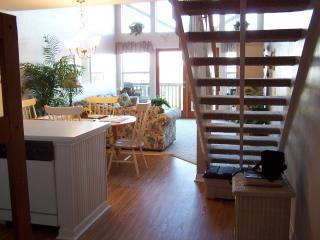 Looking toward balcony, greatroom, now have desk under stairs not shown in this picture.