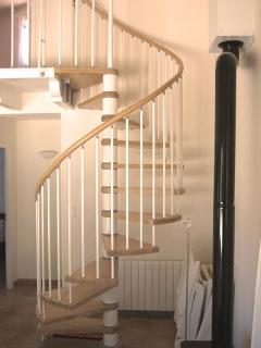 Spiral staircase leading to second bedroom