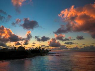 Sunrise from your Kauai condo. 305 Kuhio Shores taken by guests. Poipu, Kauai