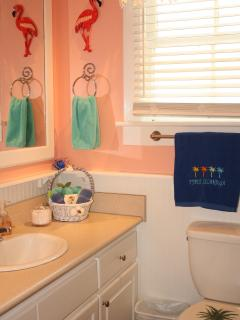 Flamingo bathrm w/5ft sink cabinet, tub/shower w/ tub surround, tile floor