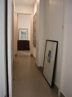 Hallway to bedrooms (guest bath on left)