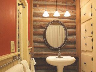 Master Bath features exposed log walls of the ORIGINAL VINTAGE LOG CABIN.