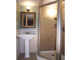 Bathroom with Corner Shower, Italian Porcelain Tile, Antique Mirror