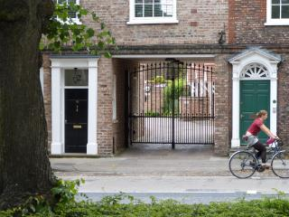 Gated entrance under grand Georgian houses on Monkgate.