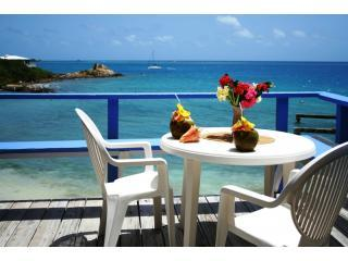 Your private deck above the beach with fabulous ocean views and azure Caribbean waters!
