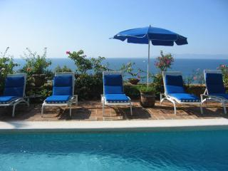 Lounging by the pool and overlooking the ocean