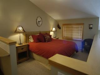 Lofted bedroom with king bed, which can be split into w single beds.