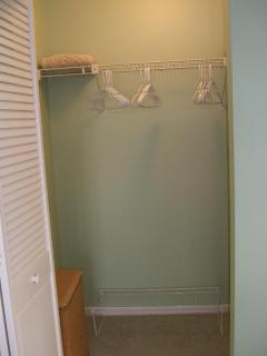 'Rare' large MBRM walk in closet, shelves, hangers, wall hooks, clothes hamper + room for luggage!