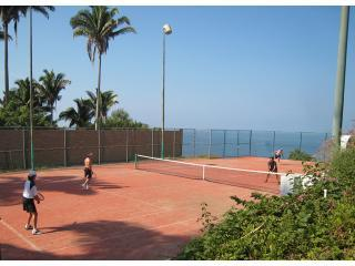 Private lighted tennis court with ocean view