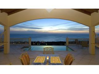 Perfect Sunset of Caribbean Sea with vanishing edge Pool