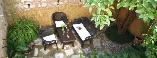 The garden patio, perfect for an outdoor breakfast or for enjoying a local aperitif.