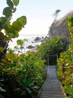 Broad wooden stairway leading to the beach