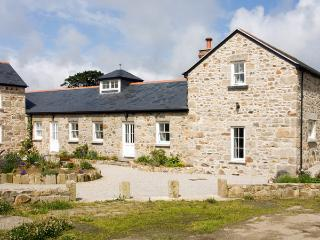 TREGOTHA BARN, pet friendly, character holiday cottage, with a garden in