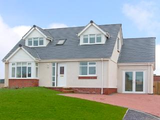 5 CAE DERWYDD, pet friendly, with a garden in Cemaes Bay, Isle Of Anglesey, Ref 2374