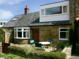 BEACH COTTAGE, pet friendly, character holiday cottage, with a garden in Beadnell, Ref 1320