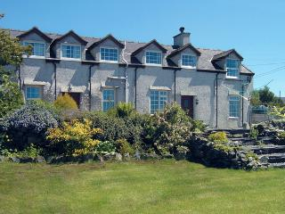GLAN Y GORS, pet friendly, character holiday cottage, with a garden in