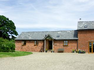 THE BYRE, character holiday cottage, with a garden in Wentnor, Ref 1502