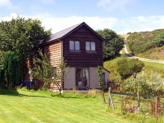 THE OLD CWM BARN, pet friendly, country holiday cottage, with a garden in Mainst