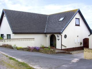 HERONS REACH, pet friendly, country holiday cottage, with a garden in Pembroke