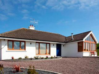 LOUGH CLUHIR COTTAGE, pet friendly, country holiday cottage, with a garden in