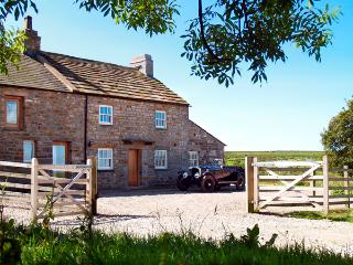 LOWER CROASDALE FARMHOUSE, pet friendly, character holiday cottage, with a garde
