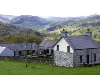 PENRHYDDION UCHA, pet friendly, country holiday cottage, with a garden in