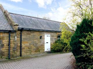 SHUNTING COTTAGE, pet friendly, character holiday cottage, with a garden in Ackl