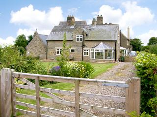 THE ANNEXE, EASTFIELD HALL, pet friendly, country holiday cottage, with a garden