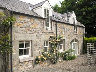 THE COACH HOUSE, pet friendly, luxury holiday cottage, with a garden in Lowick