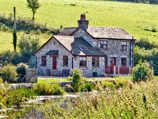 WHARF COTTAGE, pet friendly, character holiday cottage, with a garden in