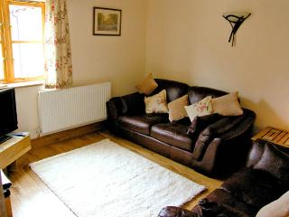 THE OLDE COWSHED, pet friendly, character holiday cottage, with a garden in