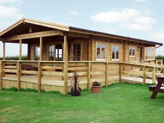 THORNLEA LOG CABIN, pet friendly, country holiday cottage, with a garden in